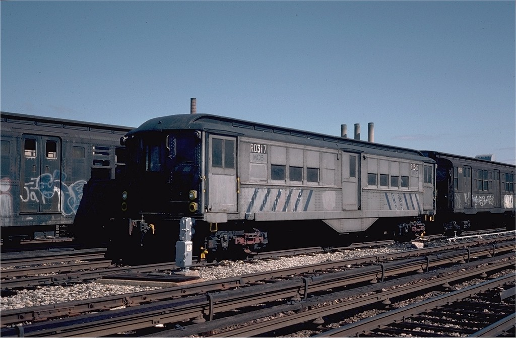(186k, 1024x671)<br><b>Country:</b> United States<br><b>City:</b> New York<br><b>System:</b> New York City Transit<br><b>Location:</b> 207th Street Yard<br><b>Car:</b> Low-V RD317 (ex-5303)<br><b>Photo by:</b> Steve Zabel<br><b>Collection of:</b> Joe Testagrose<br><b>Date:</b> 4/29/1976<br><b>Viewed (this week/total):</b> 2 / 1396