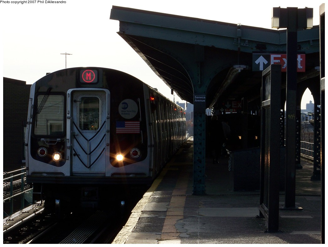 (174k, 1044x788)<br><b>Country:</b> United States<br><b>City:</b> New York<br><b>System:</b> New York City Transit<br><b>Line:</b> BMT Myrtle Avenue Line<br><b>Location:</b> Seneca Avenue <br><b>Route:</b> M<br><b>Car:</b> R-143 (Kawasaki, 2001-2002)  <br><b>Photo by:</b> Philip D'Allesandro<br><b>Date:</b> 12/1/2007<br><b>Viewed (this week/total):</b> 0 / 1285