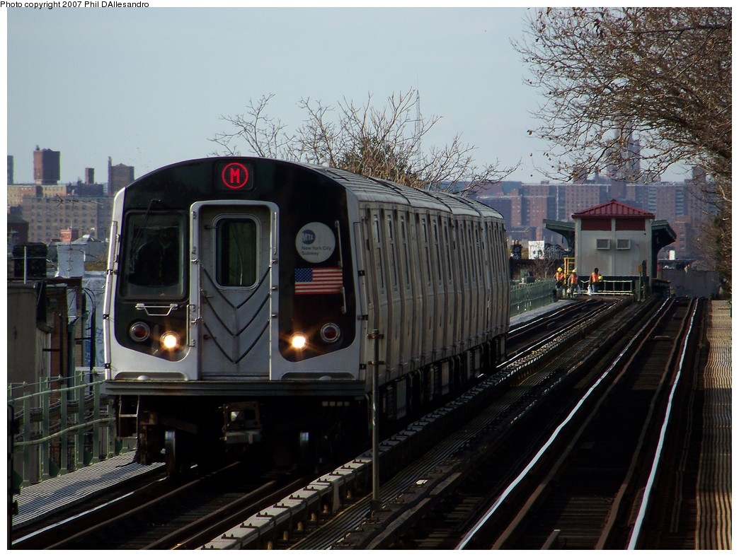 (238k, 1044x788)<br><b>Country:</b> United States<br><b>City:</b> New York<br><b>System:</b> New York City Transit<br><b>Line:</b> BMT Myrtle Avenue Line<br><b>Location:</b> Fresh Pond Road <br><b>Route:</b> M<br><b>Car:</b> R-143 (Kawasaki, 2001-2002) 8124 <br><b>Photo by:</b> Philip D'Allesandro<br><b>Date:</b> 12/1/2007<br><b>Viewed (this week/total):</b> 5 / 1771