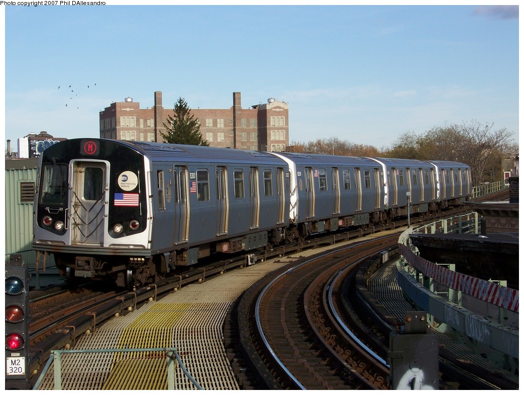 (236k, 1044x788)<br><b>Country:</b> United States<br><b>City:</b> New York<br><b>System:</b> New York City Transit<br><b>Line:</b> BMT Myrtle Avenue Line<br><b>Location:</b> Seneca Avenue <br><b>Route:</b> M<br><b>Car:</b> R-143 (Kawasaki, 2001-2002) 8300 <br><b>Photo by:</b> Philip D'Allesandro<br><b>Date:</b> 12/1/2007<br><b>Viewed (this week/total):</b> 0 / 1905