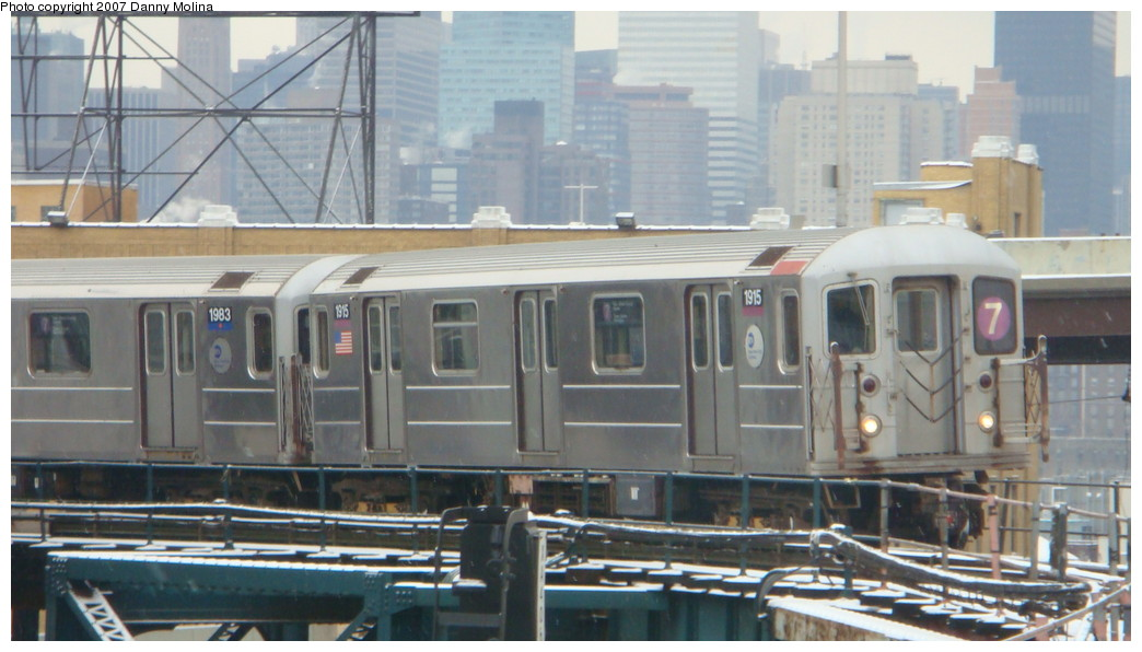 (180k, 1044x596)<br><b>Country:</b> United States<br><b>City:</b> New York<br><b>System:</b> New York City Transit<br><b>Line:</b> IRT Flushing Line<br><b>Location:</b> Queensborough Plaza <br><b>Route:</b> 7<br><b>Car:</b> R-62A (Bombardier, 1984-1987)  1915 <br><b>Photo by:</b> Danny Molina<br><b>Date:</b> 12/3/2007<br><b>Viewed (this week/total):</b> 3 / 1450