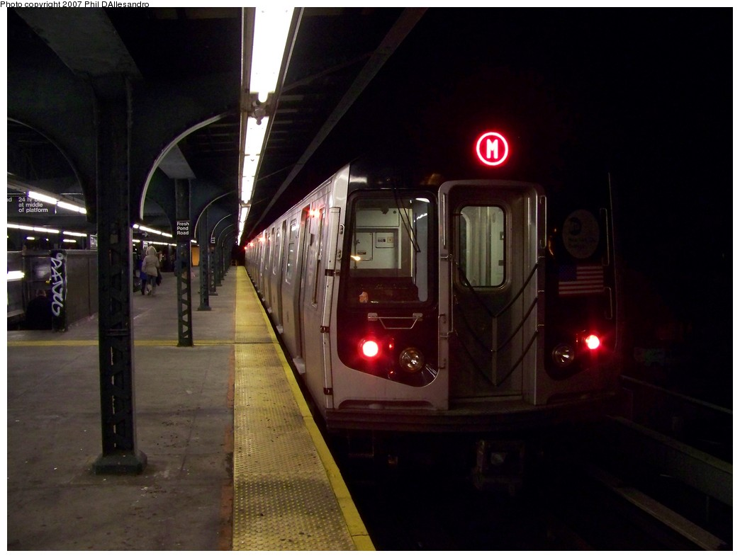(157k, 1044x788)<br><b>Country:</b> United States<br><b>City:</b> New York<br><b>System:</b> New York City Transit<br><b>Line:</b> BMT Myrtle Avenue Line<br><b>Location:</b> Fresh Pond Road <br><b>Route:</b> M<br><b>Car:</b> R-143 (Kawasaki, 2001-2002) 8177 <br><b>Photo by:</b> Philip D'Allesandro<br><b>Date:</b> 12/8/2007<br><b>Viewed (this week/total):</b> 0 / 2203