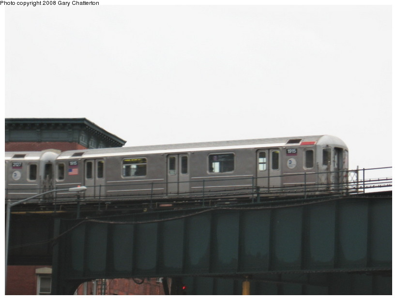 (65k, 820x620)<br><b>Country:</b> United States<br><b>City:</b> New York<br><b>System:</b> New York City Transit<br><b>Line:</b> IRT Flushing Line<br><b>Location:</b> Court House Square/45th Road <br><b>Route:</b> 7<br><b>Car:</b> R-62A (Bombardier, 1984-1987)  1915 <br><b>Photo by:</b> Gary Chatterton<br><b>Date:</b> 12/23/2007<br><b>Viewed (this week/total):</b> 2 / 888