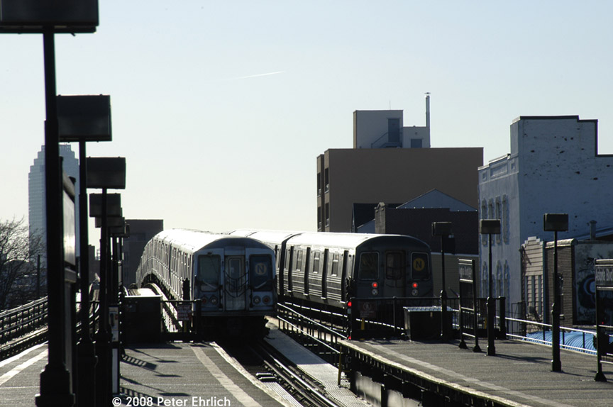 (147k, 864x574)<br><b>Country:</b> United States<br><b>City:</b> New York<br><b>System:</b> New York City Transit<br><b>Line:</b> BMT Astoria Line<br><b>Location:</b> Astoria Boulevard/Hoyt Avenue <br><b>Route:</b> N<br><b>Car:</b> R-68 (Westinghouse-Amrail, 1986-1988)  2840 <br><b>Photo by:</b> Peter Ehrlich<br><b>Date:</b> 1/3/2008<br><b>Notes:</b> Leaving Astoria Blvd. inbound, trailing view.  With 4298 on center track.<br><b>Viewed (this week/total):</b> 1 / 1732