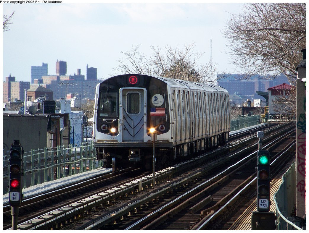 (277k, 1044x788)<br><b>Country:</b> United States<br><b>City:</b> New York<br><b>System:</b> New York City Transit<br><b>Line:</b> BMT Myrtle Avenue Line<br><b>Location:</b> Fresh Pond Road <br><b>Route:</b> M<br><b>Car:</b> R-143 (Kawasaki, 2001-2002) 8261 <br><b>Photo by:</b> Philip D'Allesandro<br><b>Date:</b> 1/20/2008<br><b>Viewed (this week/total):</b> 1 / 3580
