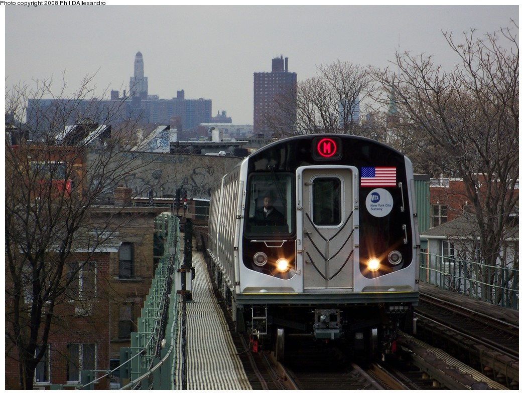 (256k, 1044x788)<br><b>Country:</b> United States<br><b>City:</b> New York<br><b>System:</b> New York City Transit<br><b>Line:</b> BMT Myrtle Avenue Line<br><b>Location:</b> Forest Avenue <br><b>Route:</b> M<br><b>Car:</b> R-160A-1 (Alstom, 2005-2008, 4 car sets)  8409 <br><b>Photo by:</b> Philip D'Allesandro<br><b>Date:</b> 2/2/2008<br><b>Notes:</b> First time ever R160s operated the M Line in service.<br><b>Viewed (this week/total):</b> 2 / 2973