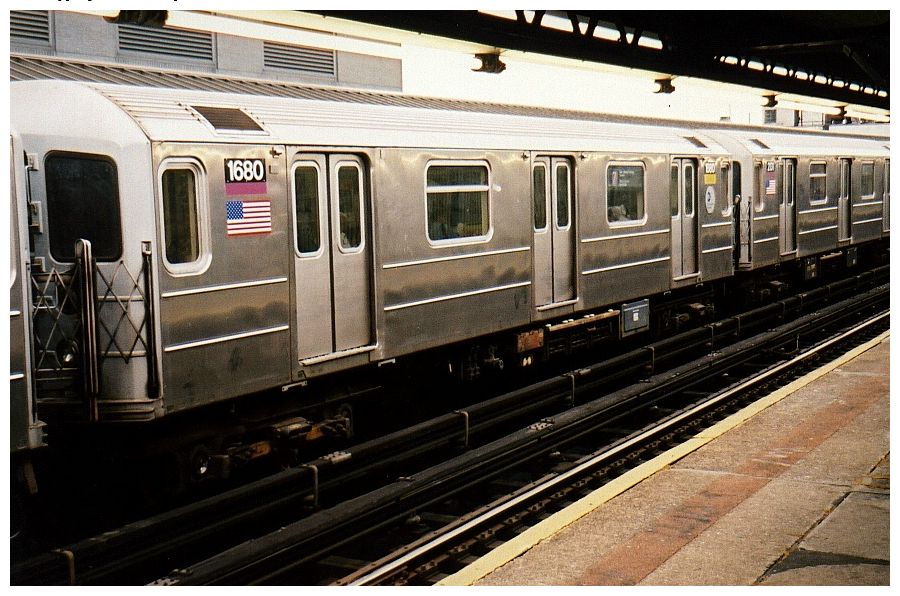 (119k, 900x596)<br><b>Country:</b> United States<br><b>City:</b> New York<br><b>System:</b> New York City Transit<br><b>Line:</b> IRT Flushing Line<br><b>Location:</b> Court House Square/45th Road <br><b>Route:</b> 7<br><b>Car:</b> R-62A (Bombardier, 1984-1987)  1680 <br><b>Photo by:</b> Gary Chatterton<br><b>Date:</b> 12/7/2002<br><b>Viewed (this week/total):</b> 2 / 2179