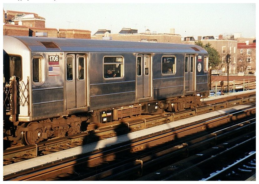 (111k, 830x591)<br><b>Country:</b> United States<br><b>City:</b> New York<br><b>System:</b> New York City Transit<br><b>Line:</b> IRT Flushing Line<br><b>Location:</b> 82nd Street/Jackson Heights <br><b>Route:</b> 7<br><b>Car:</b> R-62A (Bombardier, 1984-1987)  1706 <br><b>Photo by:</b> Gary Chatterton<br><b>Date:</b> 12/7/2002<br><b>Viewed (this week/total):</b> 4 / 2832