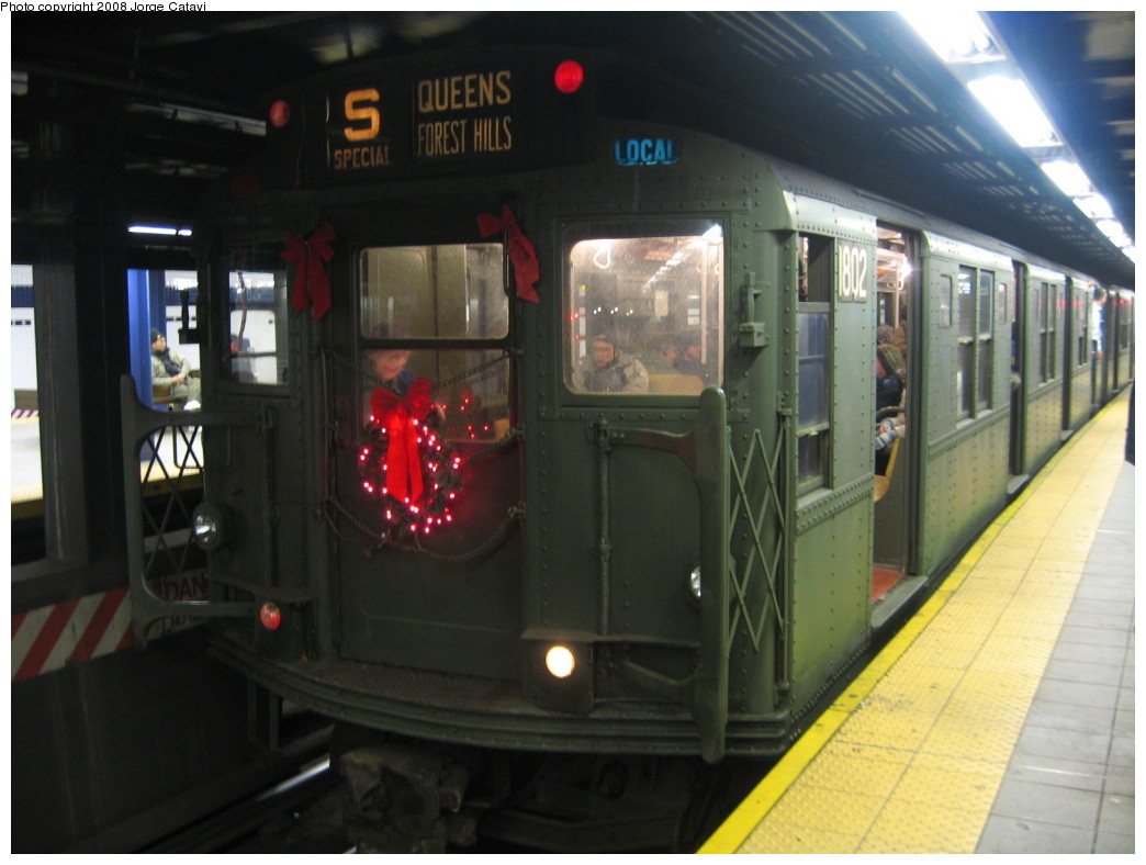 (168k, 1044x788)<br><b>Country:</b> United States<br><b>City:</b> New York<br><b>System:</b> New York City Transit<br><b>Line:</b> IND Queens Boulevard Line<br><b>Location:</b> Queens Plaza <br><b>Route:</b> Museum Train Service (V)<br><b>Car:</b> R-9 (Pressed Steel, 1940)  1802 <br><b>Photo by:</b> Jorge Catayi<br><b>Date:</b> 12/2/2007<br><b>Viewed (this week/total):</b> 3 / 1148