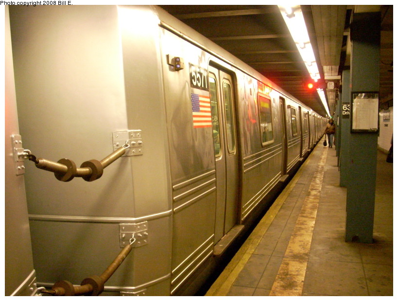 (166k, 819x619)<br><b>Country:</b> United States<br><b>City:</b> New York<br><b>System:</b> New York City Transit<br><b>Line:</b> IND Queens Boulevard Line<br><b>Location:</b> 63rd Drive/Rego Park <br><b>Route:</b> R<br><b>Car:</b> R-46 (Pullman-Standard, 1974-75) 5571 <br><b>Photo by:</b> Bill E.<br><b>Date:</b> 2/10/2008<br><b>Notes:</b> New paint on end cap.<br><b>Viewed (this week/total):</b> 0 / 1508