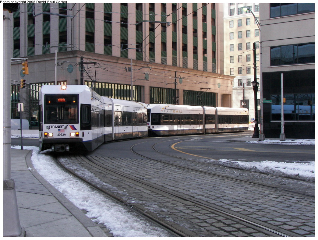 (313k, 1044x788)<br><b>Country:</b> United States<br><b>City:</b> Jersey City, NJ<br><b>System:</b> Hudson Bergen Light Rail<br><b>Location:</b> Exchange Place <br><b>Car:</b> NJT-HBLR LRV (Kinki-Sharyo, 1998-99)  2022 <br><b>Photo by:</b> David-Paul Gerber<br><b>Date:</b> 2/25/2008<br><b>Viewed (this week/total):</b> 0 / 1346