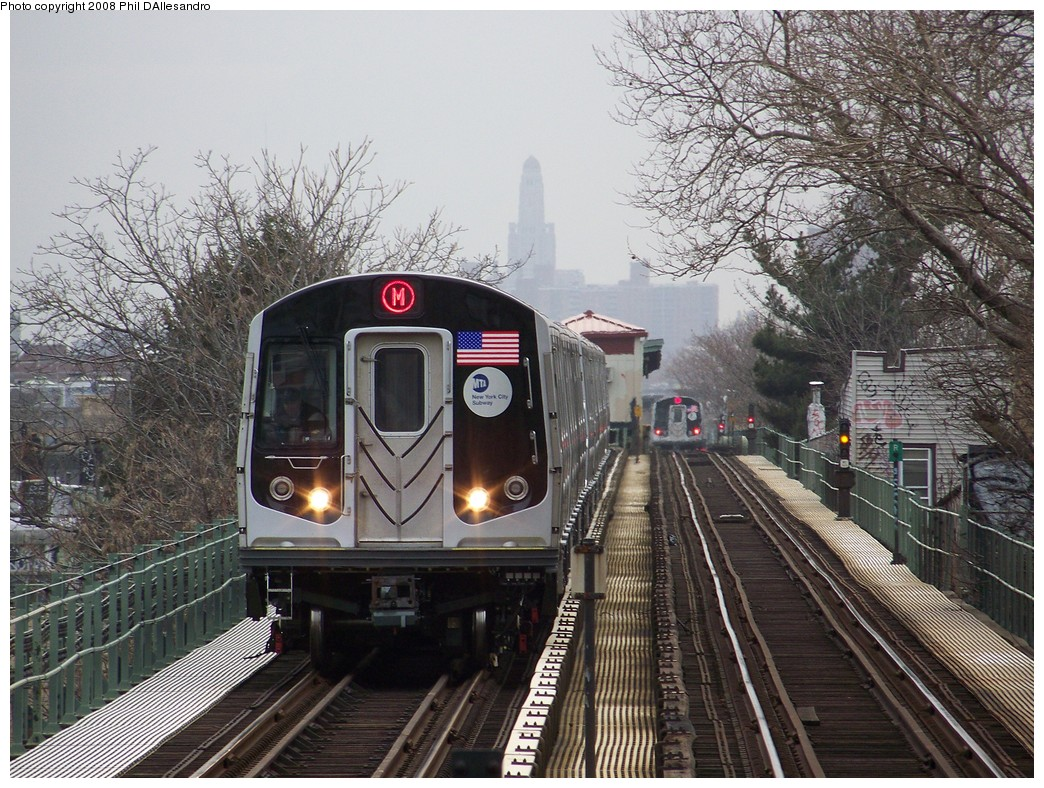 (300k, 1044x788)<br><b>Country:</b> United States<br><b>City:</b> New York<br><b>System:</b> New York City Transit<br><b>Line:</b> BMT Myrtle Avenue Line<br><b>Location:</b> Fresh Pond Road <br><b>Route:</b> M<br><b>Car:</b> R-160A-1 (Alstom, 2005-2008, 4 car sets)  8357 <br><b>Photo by:</b> Philip D'Allesandro<br><b>Date:</b> 4/7/2008<br><b>Notes:</b> First day of full 8-car R160A trains on the M line.<br><b>Viewed (this week/total):</b> 2 / 1420