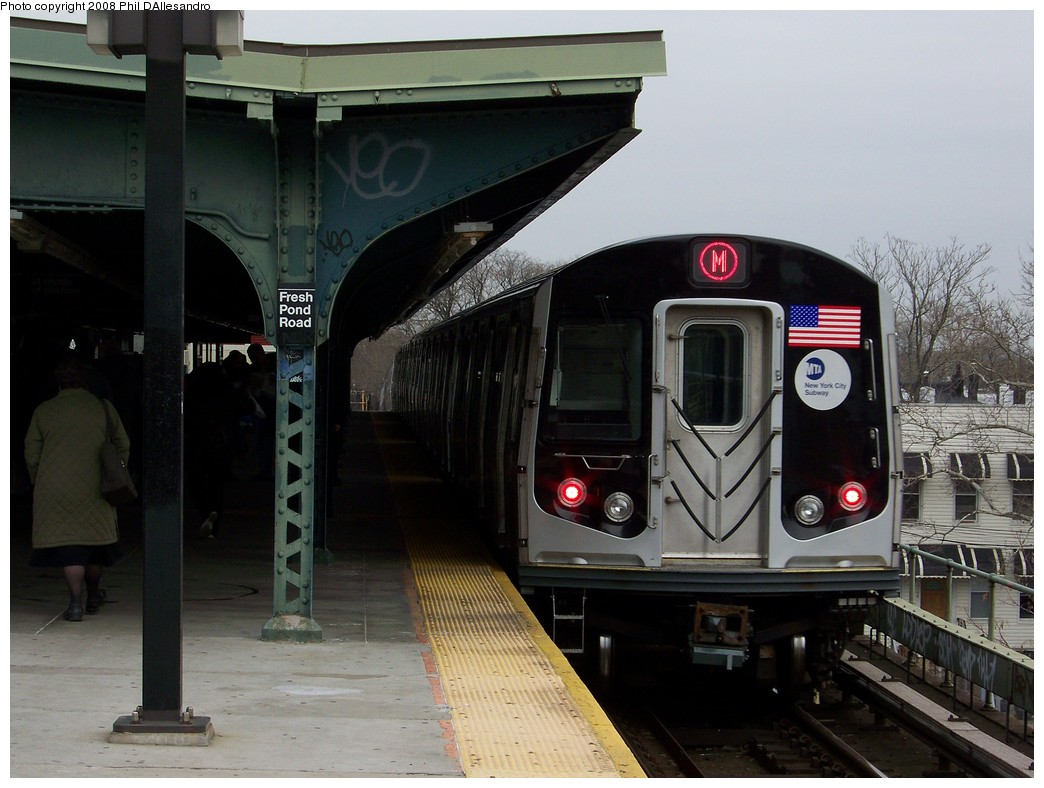 (196k, 1044x788)<br><b>Country:</b> United States<br><b>City:</b> New York<br><b>System:</b> New York City Transit<br><b>Line:</b> BMT Myrtle Avenue Line<br><b>Location:</b> Fresh Pond Road <br><b>Route:</b> M<br><b>Car:</b> R-160A-1 (Alstom, 2005-2008, 4 car sets)  8385 <br><b>Photo by:</b> Philip D'Allesandro<br><b>Date:</b> 4/7/2008<br><b>Notes:</b> First day of full 8-car R160A trains on the M line.<br><b>Viewed (this week/total):</b> 1 / 1683