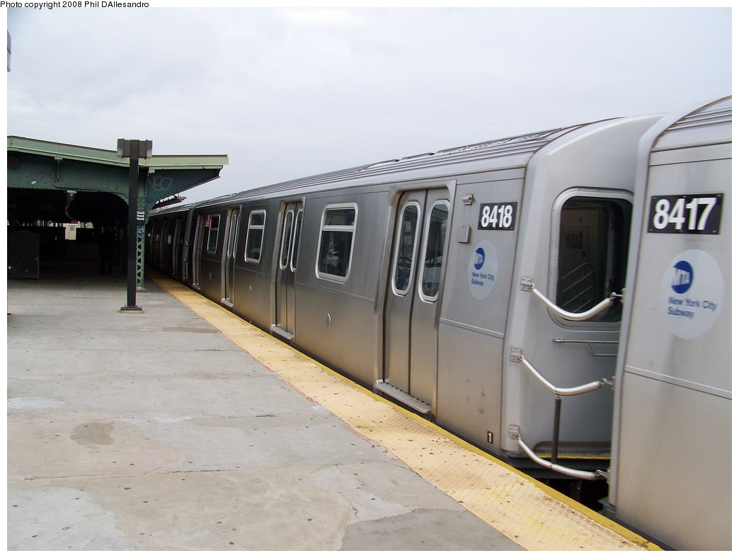 (164k, 1044x788)<br><b>Country:</b> United States<br><b>City:</b> New York<br><b>System:</b> New York City Transit<br><b>Line:</b> BMT Myrtle Avenue Line<br><b>Location:</b> Fresh Pond Road <br><b>Route:</b> M<br><b>Car:</b> R-160A-1 (Alstom, 2005-2008, 4 car sets)  8418 <br><b>Photo by:</b> Philip D'Allesandro<br><b>Date:</b> 4/7/2008<br><b>Notes:</b> First day of full 8-car R160A trains on the M line.<br><b>Viewed (this week/total):</b> 0 / 1400