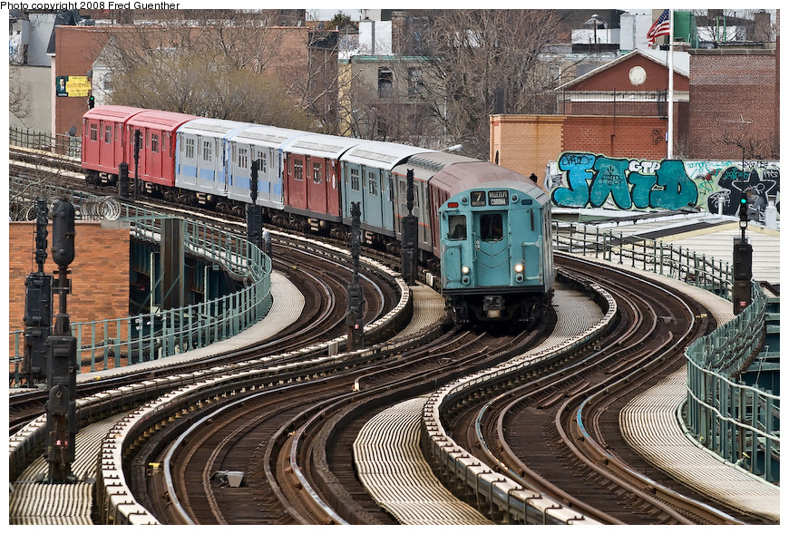 (310k, 870x589)<br><b>Country:</b> United States<br><b>City:</b> New York<br><b>System:</b> New York City Transit<br><b>Line:</b> IRT Flushing Line<br><b>Location:</b> 61st Street/Woodside <br><b>Route:</b> Museum Train Service (7)<br><b>Car:</b> R-33 World's Fair (St. Louis, 1963-64) 9306 <br><b>Photo by:</b> Fred Guenther<br><b>Date:</b> 4/8/2008<br><b>Notes:</b> Coming down the hill to Woodside.<br><b>Viewed (this week/total):</b> 1 / 2006