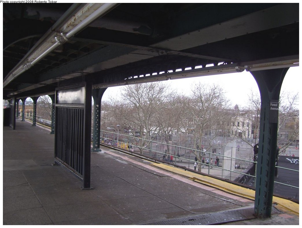 (209k, 1044x790)<br><b>Country:</b> United States<br><b>City:</b> New York<br><b>System:</b> New York City Transit<br><b>Line:</b> BMT Myrtle Avenue Line<br><b>Location:</b> Forest Avenue <br><b>Photo by:</b> Roberto C. Tobar<br><b>Date:</b> 4/12/2008<br><b>Notes:</b> Platform view.<br><b>Viewed (this week/total):</b> 3 / 1450