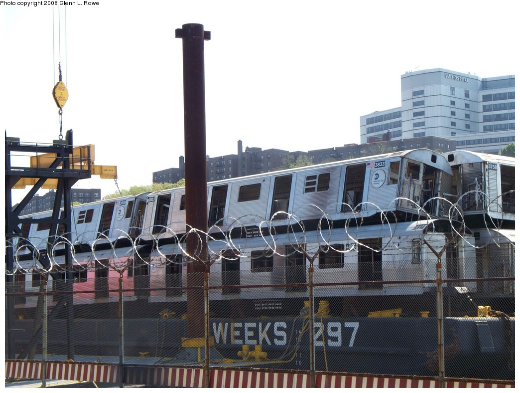 (230k, 1044x788)<br><b>Country:</b> United States<br><b>City:</b> New York<br><b>System:</b> New York City Transit<br><b>Location:</b> 207th Street Yard<br><b>Car:</b> R-32 (Budd, 1964)  3833 <br><b>Photo by:</b> Glenn L. Rowe<br><b>Date:</b> 5/6/2008<br><b>Notes:</b> Barge-Scrapping<br><b>Viewed (this week/total):</b> 4 / 1544