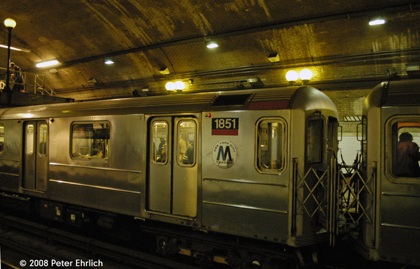 (188k, 864x554)<br><b>Country:</b> United States<br><b>City:</b> New York<br><b>System:</b> New York City Transit<br><b>Line:</b> IRT West Side Line<br><b>Location:</b> 168th Street <br><b>Car:</b> R-62A (Bombardier, 1984-1987)  1851 <br><b>Photo by:</b> Peter Ehrlich<br><b>Date:</b> 5/2/2008<br><b>Notes:</b> Note old logo (MTA logo peeled off).<br><b>Viewed (this week/total):</b> 1 / 2111