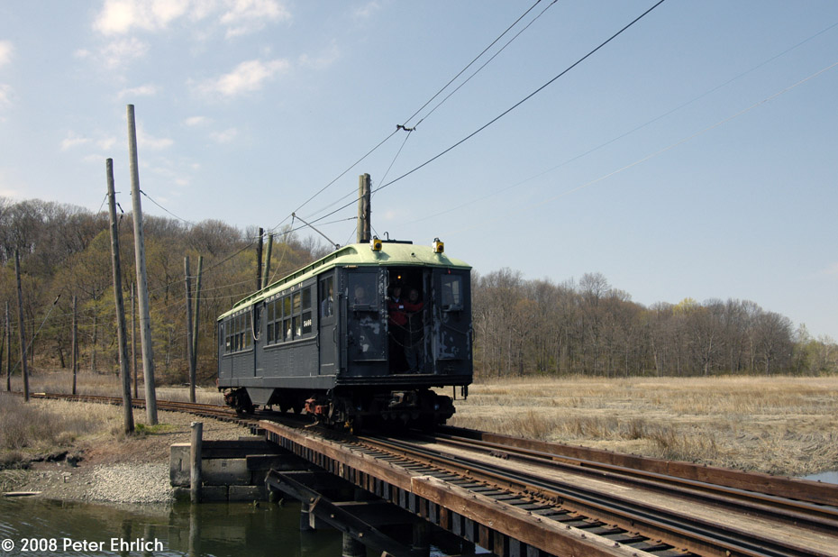 (188k, 930x618)<br><b>Country:</b> United States<br><b>City:</b> East Haven/Branford, Ct.<br><b>System:</b> Shore Line Trolley Museum <br><b>Car:</b> Low-V 5466 <br><b>Photo by:</b> Peter Ehrlich<br><b>Date:</b> 4/26/2008<br><b>Notes:</b> Crossing trestle west of South Beach eastbound.<br><b>Viewed (this week/total):</b> 0 / 949