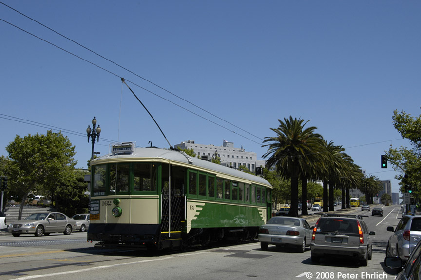 (151k, 864x574)<br><b>Country:</b> United States<br><b>City:</b> San Francisco/Bay Area, CA<br><b>System:</b> SF MUNI<br><b>Location:</b> Market/Church/14th <br><b>Car:</b> SF MUNI B-Type (Jewett Car Co, 1914)  162 <br><b>Photo by:</b> Peter Ehrlich<br><b>Date:</b> 5/17/2008<br><b>Notes:</b> Market/14th Street inbound, trailing view, after turning from Church Street. With PCC 1063 (Baltimore) outbound on the right.<br><b>Viewed (this week/total):</b> 0 / 417