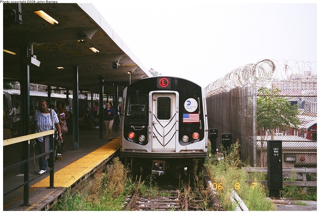 (271k, 1044x699)<br><b>Country:</b> United States<br><b>City:</b> New York<br><b>System:</b> New York City Transit<br><b>Line:</b> BMT Canarsie Line<br><b>Location:</b> Rockaway Parkway <br><b>Route:</b> L<br><b>Car:</b> R-143 (Kawasaki, 2001-2002) 8117 <br><b>Photo by:</b> John Barnes<br><b>Date:</b> 8/6/2006<br><b>Viewed (this week/total):</b> 3 / 1654
