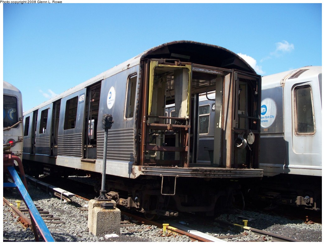 (220k, 1044x788)<br><b>Country:</b> United States<br><b>City:</b> New York<br><b>System:</b> New York City Transit<br><b>Location:</b> 207th Street Yard<br><b>Car:</b> R-42 (St. Louis, 1969-1970)  4879 <br><b>Photo by:</b> Glenn L. Rowe<br><b>Date:</b> 6/19/2008<br><b>Notes:</b> Scrap<br><b>Viewed (this week/total):</b> 1 / 1124