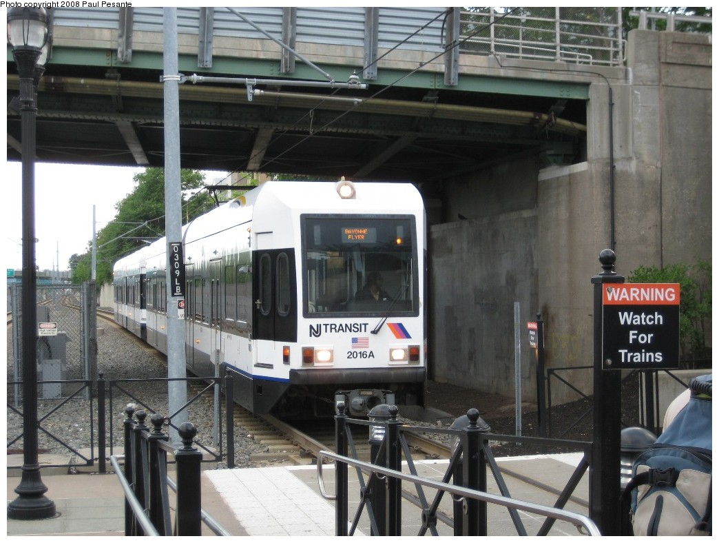 (217k, 1044x788)<br><b>Country:</b> United States<br><b>City:</b> Bayonne, NJ<br><b>System:</b> Hudson Bergen Light Rail<br><b>Location:</b> East 45th Street <br><b>Car:</b> NJT-HBLR LRV (Kinki-Sharyo, 1998-99)  2016 <br><b>Photo by:</b> Paul Pesante<br><b>Date:</b> 6/19/2008<br><b>Notes:</b> Bayonne Flyer express running wrong rail.<br><b>Viewed (this week/total):</b> 0 / 455