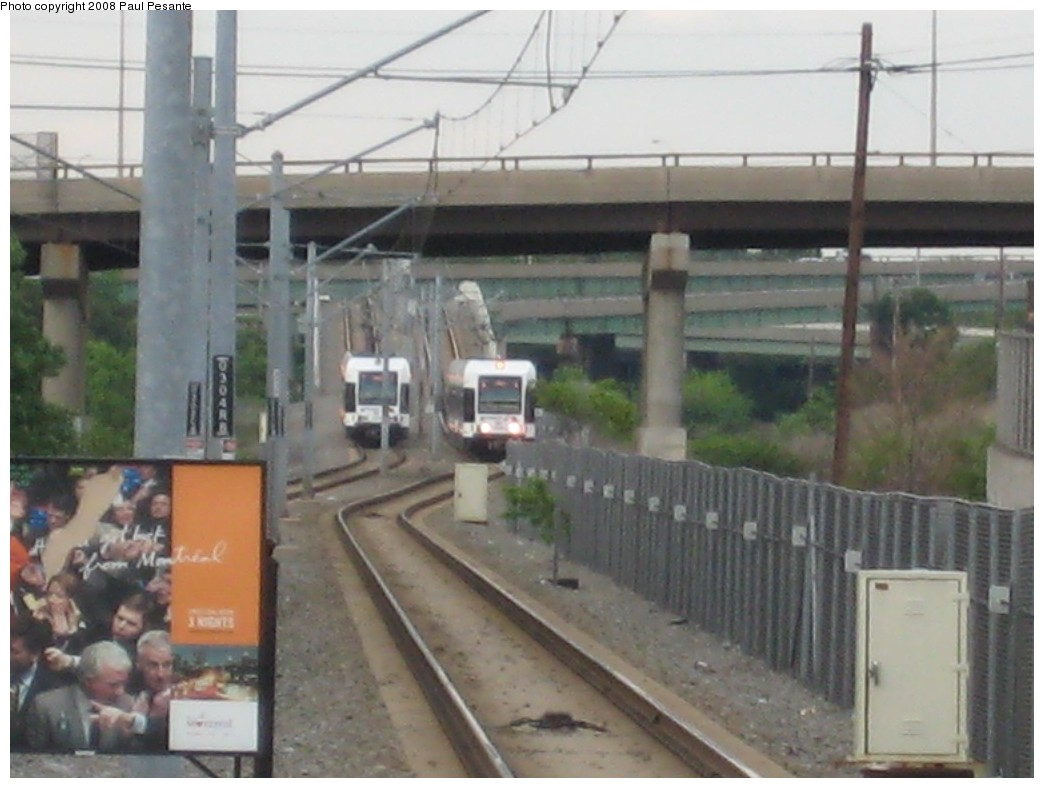 (155k, 1044x788)<br><b>Country:</b> United States<br><b>City:</b> Bayonne, NJ<br><b>System:</b> Hudson Bergen Light Rail<br><b>Location:</b> East 45th Street <br><b>Car:</b> NJT-HBLR LRV (Kinki-Sharyo, 1998-99)  2009 <br><b>Photo by:</b> Paul Pesante<br><b>Date:</b> 6/19/2008<br><b>Notes:</b> Meet between trains at Conrail overpass. Southbound train approaching (on the right), running wrong rail during Bayonne Flyer service interval.<br><b>Viewed (this week/total):</b> 0 / 618