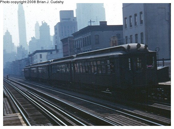 (59k, 563x416)<br><b>Country:</b> United States<br><b>City:</b> New York<br><b>System:</b> New York City Transit<br><b>Line:</b> 3rd Avenue El<br><b>Location:</b> 59th Street <br><b>Car:</b> MUDC  <br><b>Photo by:</b> Brian J. Cudahy<br><b>Date:</b> 1955<br><b>Notes:</b> Southbound train at 59th Street.<br><b>Viewed (this week/total):</b> 1 / 1730