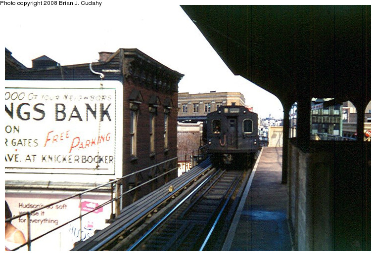(166k, 760x518)<br><b>Country:</b> United States<br><b>City:</b> New York<br><b>System:</b> New York City Transit<br><b>Line:</b> BMT Myrtle Avenue Line<br><b>Location:</b> Wyckoff Avenue <br><b>Car:</b> BMT Multi  <br><b>Photo by:</b> Brian J. Cudahy<br><b>Date:</b> 3/1960<br><b>Notes:</b> Multi section train in Myrtle-Chambers service enters Wyckoff Avenue enroute to Chambers Street.<br><b>Viewed (this week/total):</b> 0 / 1392