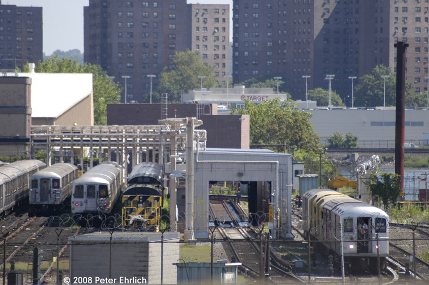 (200k, 864x574)<br><b>Country:</b> United States<br><b>City:</b> New York<br><b>System:</b> New York City Transit<br><b>Location:</b> 207th Street Yard<br><b>Photo by:</b> Peter Ehrlich<br><b>Date:</b> 7/15/2008<br><b>Notes:</b> General overview from 207th Street Bridge.  Trash train on right.<br><b>Viewed (this week/total):</b> 2 / 1014