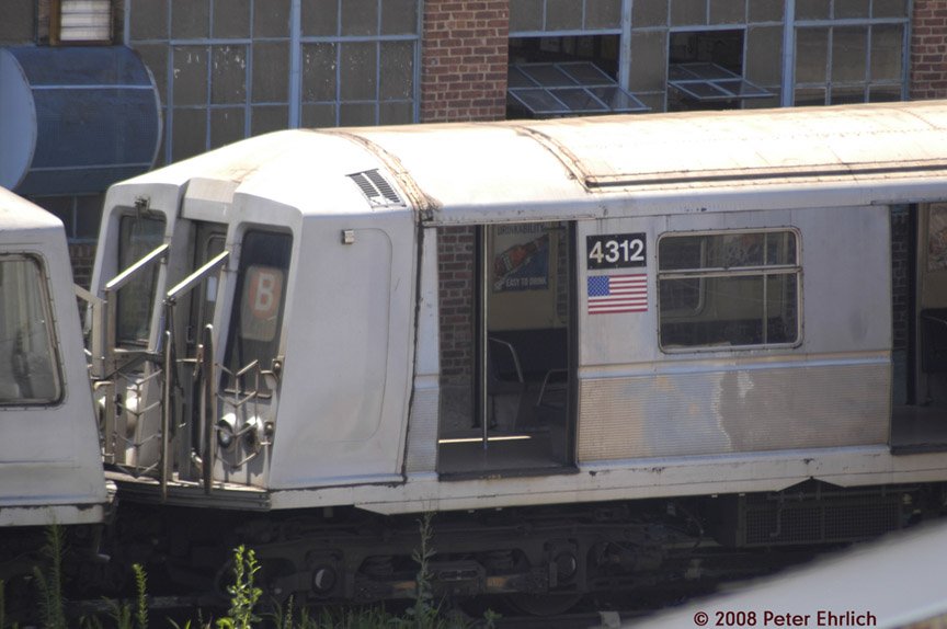 (142k, 864x574)<br><b>Country:</b> United States<br><b>City:</b> New York<br><b>System:</b> New York City Transit<br><b>Location:</b> 207th Street Yard<br><b>Car:</b> R-40 (St. Louis, 1968)  4312 <br><b>Photo by:</b> Peter Ehrlich<br><b>Date:</b> 7/15/2008<br><b>Notes:</b> R40s being set up for scrap line.<br><b>Viewed (this week/total):</b> 0 / 1453