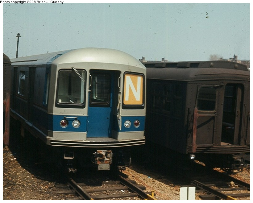 (125k, 820x658)<br><b>Country:</b> United States<br><b>City:</b> New York<br><b>System:</b> New York City Transit<br><b>Location:</b> Rockaway Parkway (Canarsie) Yard<br><b>Car:</b> R-40M (St. Louis, 1969)  4303 <br><b>Photo by:</b> Brian J. Cudahy<br><b>Date:</b> 4/9/1969<br><b>Notes:</b> R-40M and BMT Standards at Rockaway Parkway Yard.<br><b>Viewed (this week/total):</b> 0 / 1184
