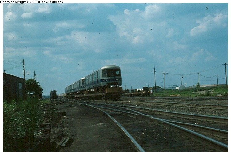 (101k, 751x506)<br><b>Country:</b> United States<br><b>City:</b> New York<br><b>System:</b> New York City Transit<br><b>Car:</b> R-46 (Pullman-Standard, 1974-75)  <br><b>Collection of:</b> Brian J. Cudahy<br><b>Date:</b> 7/1976<br><b>Notes:</b> Pullman-built R-46 units about to be shipped east. (Near Chicago).<br><b>Viewed (this week/total):</b> 1 / 1266