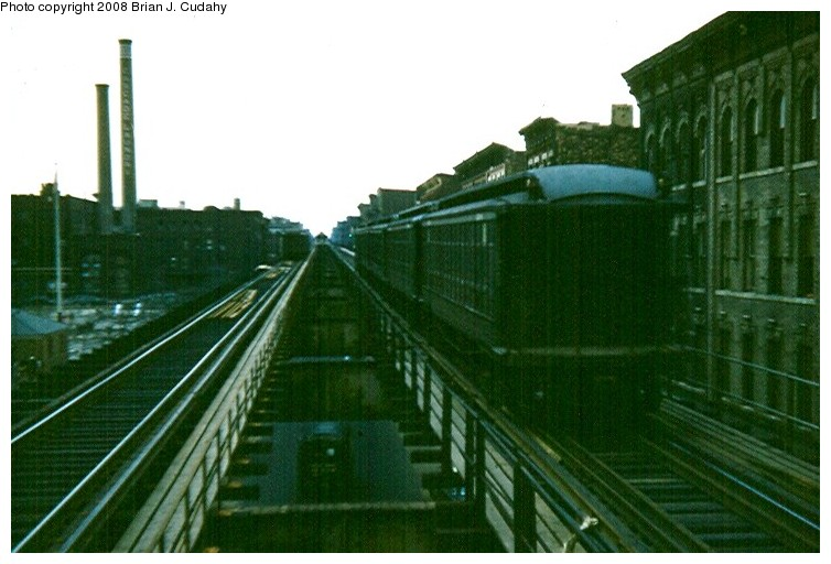 (111k, 754x512)<br><b>Country:</b> United States<br><b>City:</b> New York<br><b>System:</b> New York City Transit<br><b>Line:</b> BMT Myrtle Avenue Line<br><b>Location:</b> Nostrand Avenue <br><b>Car:</b> BMT Elevated Gate Car  <br><b>Photo by:</b> Brian J. Cudahy<br><b>Date:</b> 3/1960<br><b>Notes:</b> Cascade laundry buildings at left still exist in 2008<br><b>Viewed (this week/total):</b> 8 / 2031