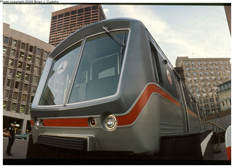 (129k, 820x589)<br><b>Country:</b> United States<br><b>City:</b> Boston, MA<br><b>System:</b> MBTA<br><b>Car:</b> SOAC  <br><b>Photo by:</b> Brian J. Cudahy<br><b>Notes:</b> Not the real SOAC, but an unpowered mock-up that was hauled around the country on trailers as part of the overall demonstration. Boston City Hall. Summer 1975.<br><b>Viewed (this week/total):</b> 8 / 1547