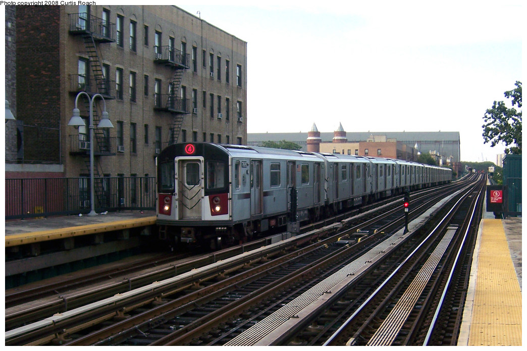 (268k, 1044x695)<br><b>Country:</b> United States<br><b>City:</b> New York<br><b>System:</b> New York City Transit<br><b>Line:</b> IRT Woodlawn Line<br><b>Location:</b> Fordham Road <br><b>Route:</b> 4<br><b>Car:</b> R-142A (Option Order, Kawasaki, 2002-2003)  7695 <br><b>Photo by:</b> Curtis Roach<br><b>Date:</b> 8/2/2008<br><b>Viewed (this week/total):</b> 2 / 1268