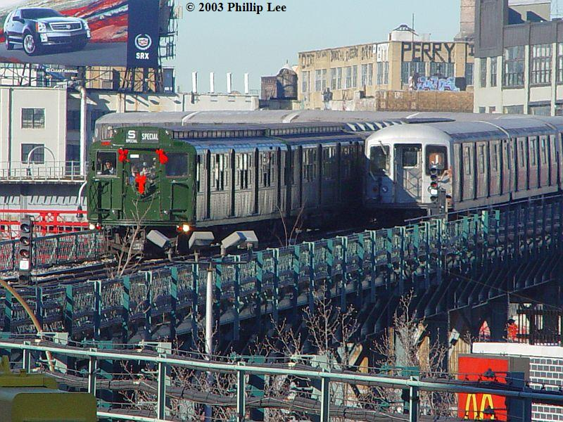 (135k, 800x600)<br><b>Country:</b> United States<br><b>City:</b> New York<br><b>System:</b> New York City Transit<br><b>Line:</b> BMT Nassau Street/Jamaica Line<br><b>Location:</b> Marcy Avenue <br><b>Route:</b> Fan Trip<br><b>Car:</b> R-4 (American Car & Foundry, 1932-1933) 484 <br><b>Photo by:</b> Phillip Lee<br><b>Date:</b> 12/28/2003<br><b>Viewed (this week/total):</b> 6 / 1197