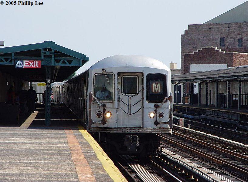 (102k, 817x600)<br><b>Country:</b> United States<br><b>City:</b> New York<br><b>System:</b> New York City Transit<br><b>Line:</b> BMT West End Line<br><b>Location:</b> 18th Avenue <br><b>Route:</b> M<br><b>Car:</b> R-42 (St. Louis, 1969-1970)   <br><b>Photo by:</b> Phillip Lee<br><b>Date:</b> 7/28/2005<br><b>Viewed (this week/total):</b> 0 / 716