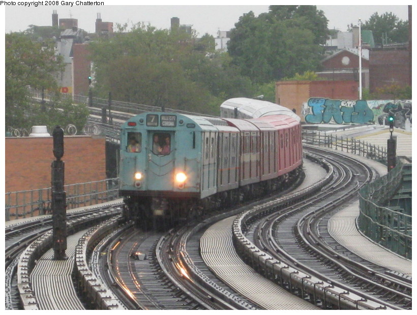 (157k, 820x620)<br><b>Country:</b> United States<br><b>City:</b> New York<br><b>System:</b> New York City Transit<br><b>Line:</b> IRT Flushing Line<br><b>Location:</b> 61st Street/Woodside <br><b>Route:</b> Museum Train Service (7)<br><b>Car:</b> R-33 World's Fair (St. Louis, 1963-64) 9306 <br><b>Photo by:</b> Gary Chatterton<br><b>Date:</b> 9/28/2008<br><b>Notes:</b> Shea Stadium closing day special<br><b>Viewed (this week/total):</b> 0 / 968