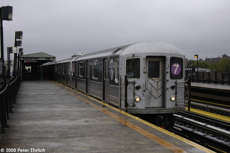 (174k, 930x618)<br><b>Country:</b> United States<br><b>City:</b> New York<br><b>System:</b> New York City Transit<br><b>Line:</b> IRT Flushing Line<br><b>Location:</b> 69th Street/Fisk Avenue <br><b>Route:</b> 7<br><b>Car:</b> R-62A (Bombardier, 1984-1987)  1696 <br><b>Photo by:</b> Peter Ehrlich<br><b>Date:</b> 9/28/2008<br><b>Notes:</b> 69 Street-Fisk Avenue, inbound train.<br><b>Viewed (this week/total):</b> 0 / 666