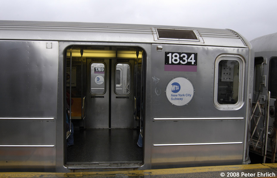 (148k, 930x600)<br><b>Country:</b> United States<br><b>City:</b> New York<br><b>System:</b> New York City Transit<br><b>Line:</b> IRT Flushing Line<br><b>Location:</b> 103rd Street/Corona Plaza <br><b>Route:</b> 7<br><b>Car:</b> R-62A (Bombardier, 1984-1987)  1834 <br><b>Photo by:</b> Peter Ehrlich<br><b>Date:</b> 9/28/2008<br><b>Notes:</b> 103 St-Corona Plaza inbound.  1769, outbound, is visible through the doors.<br><b>Viewed (this week/total):</b> 2 / 1104