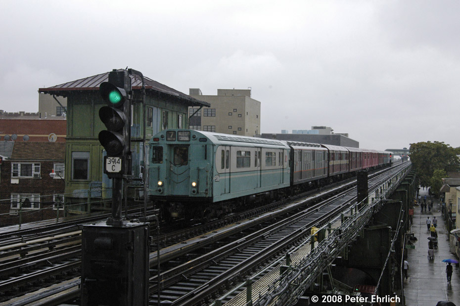 (187k, 930x618)<br><b>Country:</b> United States<br><b>City:</b> New York<br><b>System:</b> New York City Transit<br><b>Line:</b> IRT Flushing Line<br><b>Location:</b> 103rd Street/Corona Plaza <br><b>Route:</b> Museum Train Service (7)<br><b>Car:</b> R-33 World's Fair (St. Louis, 1963-64) 9306 <br><b>Photo by:</b> Peter Ehrlich<br><b>Date:</b> 9/28/2008<br><b>Notes:</b> Approaching 103 St-Corona Plaza outbound.<br><b>Viewed (this week/total):</b> 0 / 834