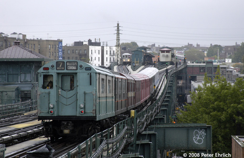 (199k, 930x602)<br><b>Country:</b> United States<br><b>City:</b> New York<br><b>System:</b> New York City Transit<br><b>Line:</b> IRT Flushing Line<br><b>Location:</b> 69th Street/Fisk Avenue <br><b>Route:</b> Museum Train Service (7)<br><b>Car:</b> R-33 World's Fair (St. Louis, 1963-64) 9306 <br><b>Photo by:</b> Peter Ehrlich<br><b>Date:</b> 8/28/2008<br><b>Notes:</b> Leaving 69 St-Fisk Avenue inbound, trailing view.<br><b>Viewed (this week/total):</b> 0 / 979