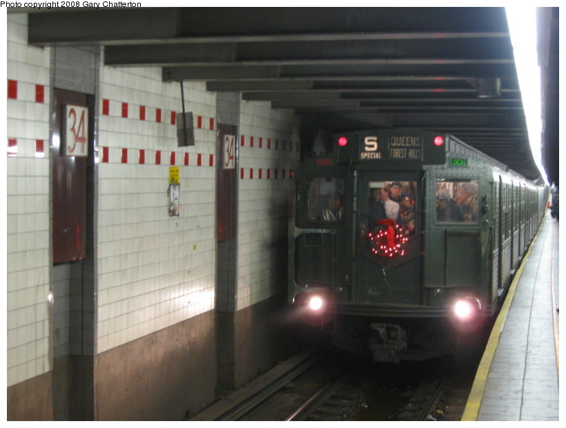 (106k, 820x620)<br><b>Country:</b> United States<br><b>City:</b> New York<br><b>System:</b> New York City Transit<br><b>Line:</b> IND 6th Avenue Line<br><b>Location:</b> 34th Street/Herald Square <br><b>Route:</b> Museum Train Service (V)<br><b>Car:</b> R-1 (American Car & Foundry, 1930-1931) 100 <br><b>Photo by:</b> Gary Chatterton<br><b>Date:</b> 11/30/2008<br><b>Viewed (this week/total):</b> 1 / 929