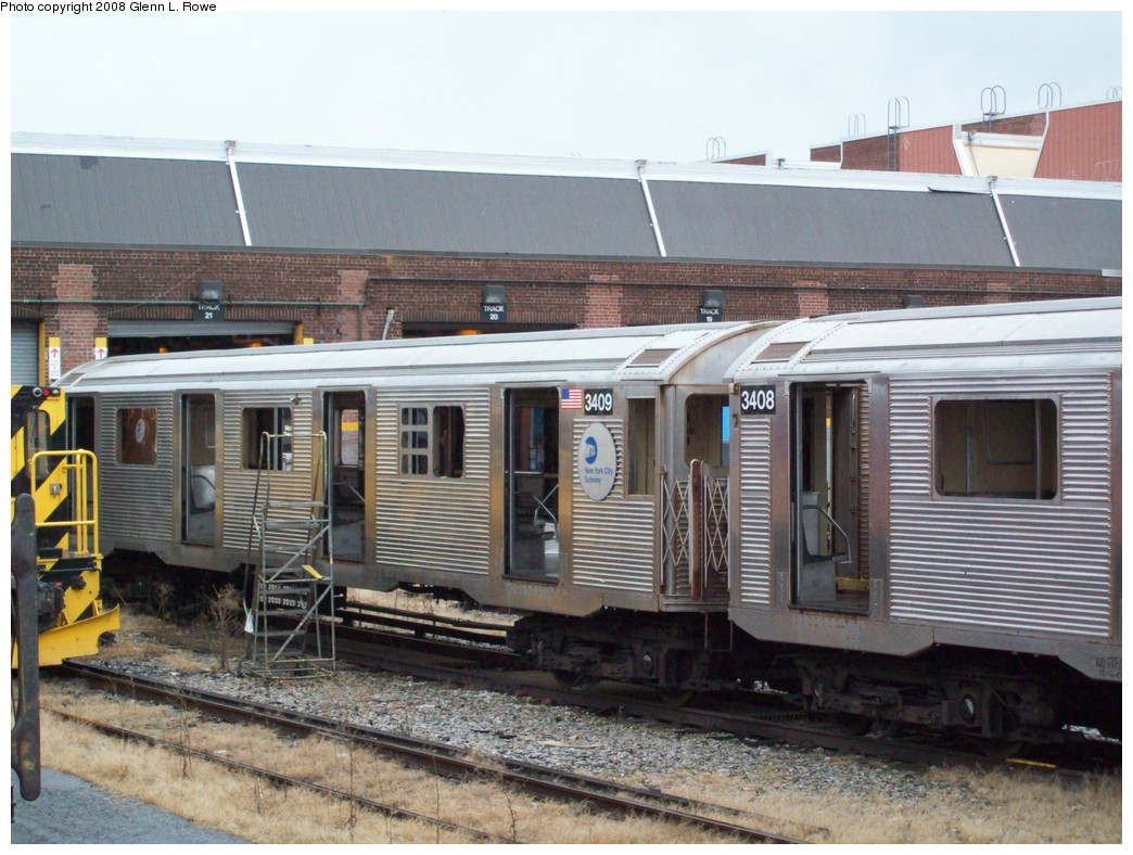 (225k, 1044x788)<br><b>Country:</b> United States<br><b>City:</b> New York<br><b>System:</b> New York City Transit<br><b>Location:</b> 207th Street Yard<br><b>Car:</b> R-32 (Budd, 1964)  3409 <br><b>Photo by:</b> Glenn L. Rowe<br><b>Date:</b> 12/10/2008<br><b>Notes:</b> Scrap<br><b>Viewed (this week/total):</b> 2 / 856