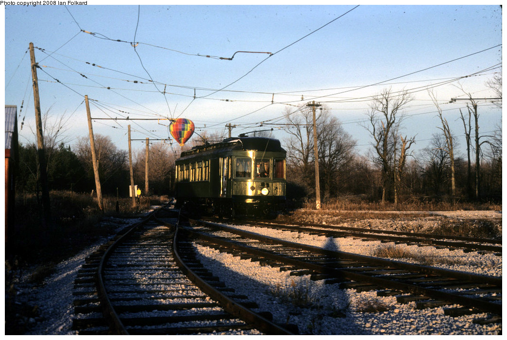 (301k, 1044x700)<br><b>Country:</b> Canada<br><b>City:</b> Toronto<br><b>System:</b> Halton County Radial Railway <br><b>Photo by:</b> Ian Folkard<br><b>Date:</b> 11/1981<br><b>Notes:</b> Montreal and Southern Counties 107 and a balloon.<br><b>Viewed (this week/total):</b> 4 / 525