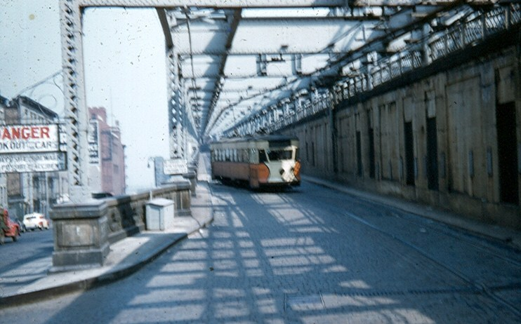 (105k, 742x462)<br><b>Country:</b> United States<br><b>City:</b> New York<br><b>System:</b> Queensborough Bridge Railway<br><b>Photo by:</b> Brian J. Cudahy<br><b>Date:</b> 5/4/1955<br><b>Notes:</b> QBRy car heading off the bridge into the underground Manhattan terminal.<br><b>Viewed (this week/total):</b> 1 / 1151