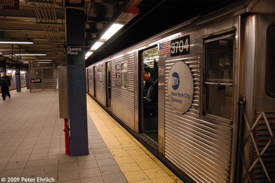 (223k, 900x598)<br><b>Country:</b> United States<br><b>City:</b> New York<br><b>System:</b> New York City Transit<br><b>Line:</b> IND Queens Boulevard Line<br><b>Location:</b> Queens Plaza <br><b>Route:</b> E<br><b>Car:</b> R-32 (Budd, 1964)  3704 <br><b>Photo by:</b> Peter Ehrlich<br><b>Date:</b> 12/28/2008<br><b>Notes:</b> E Line outbound.<br><b>Viewed (this week/total):</b> 1 / 766