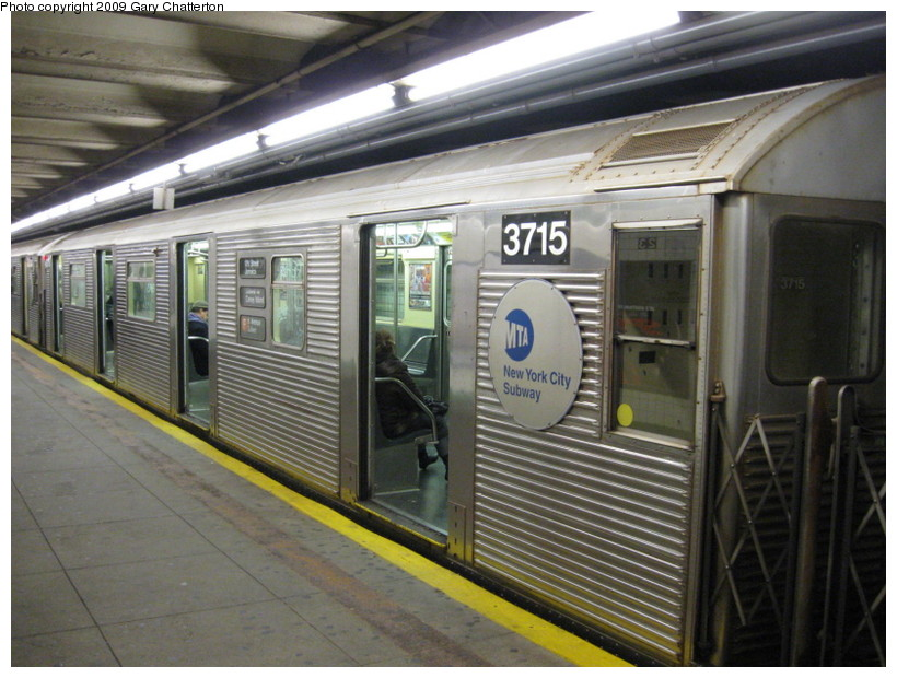 (148k, 820x620)<br><b>Country:</b> United States<br><b>City:</b> New York<br><b>System:</b> New York City Transit<br><b>Line:</b> IND 6th Avenue Line<br><b>Location:</b> 23rd Street <br><b>Route:</b> F<br><b>Car:</b> R-32 (Budd, 1964)  3715 <br><b>Photo by:</b> Gary Chatterton<br><b>Date:</b> 12/14/2008<br><b>Viewed (this week/total):</b> 0 / 738